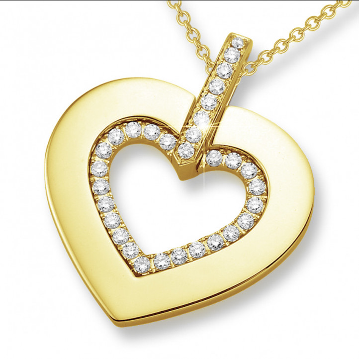 0.36 carat heart shaped yellow golden pendant with small round diamonds