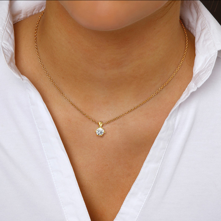 1.00 carat yellow golden solitaire pendant with round diamond