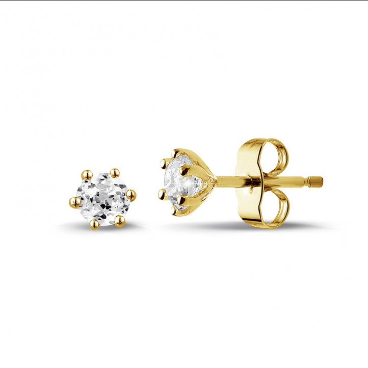 0.60 carat classic diamond earrings in yellow gold with six prongs
