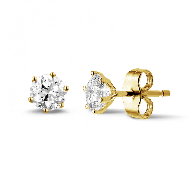 1.00 carat classic diamond earrings in yellow gold with six prongs