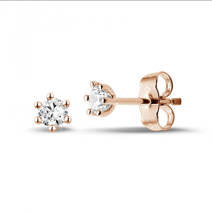 0.30 carat classic diamond earrings in red gold with six prongs
