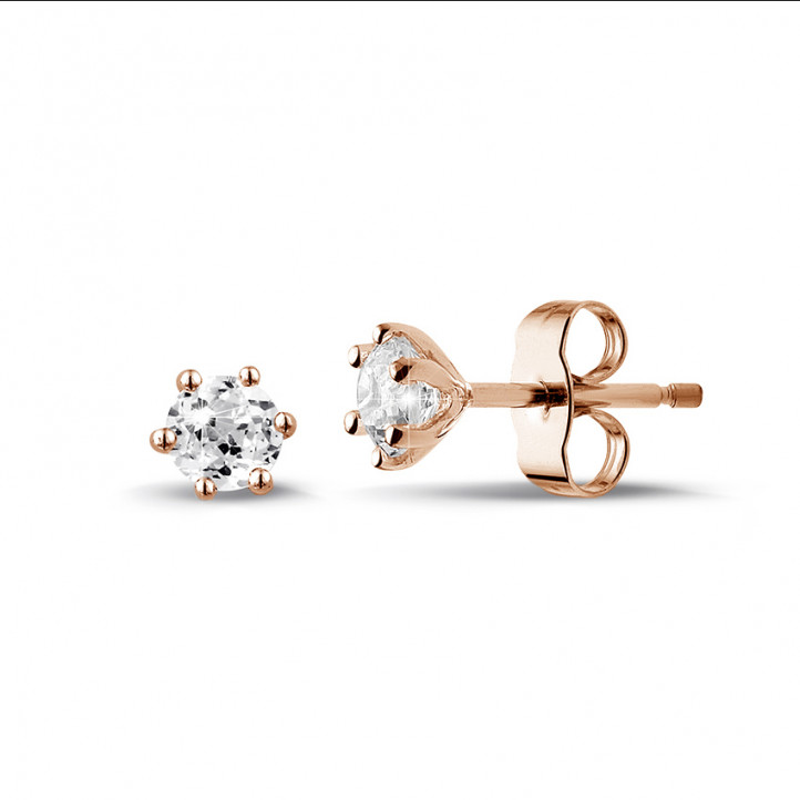 0.60 carat classic diamond earrings in red gold with six prongs