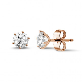 1.00 carat classic diamond earrings in red gold with six prongs