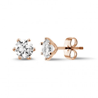 1.50 carat classic diamond earrings in red gold with six prongs