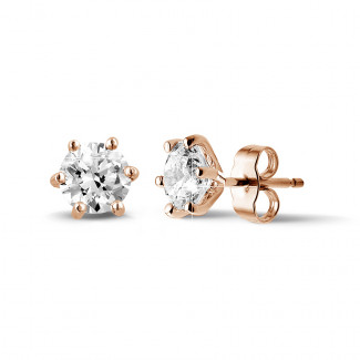 2.00 carat classic diamond earrings in red gold with six prongs