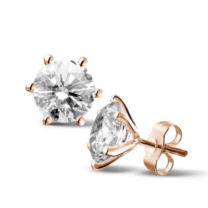 4.00 carat classic diamond earrings in red gold with six prongs