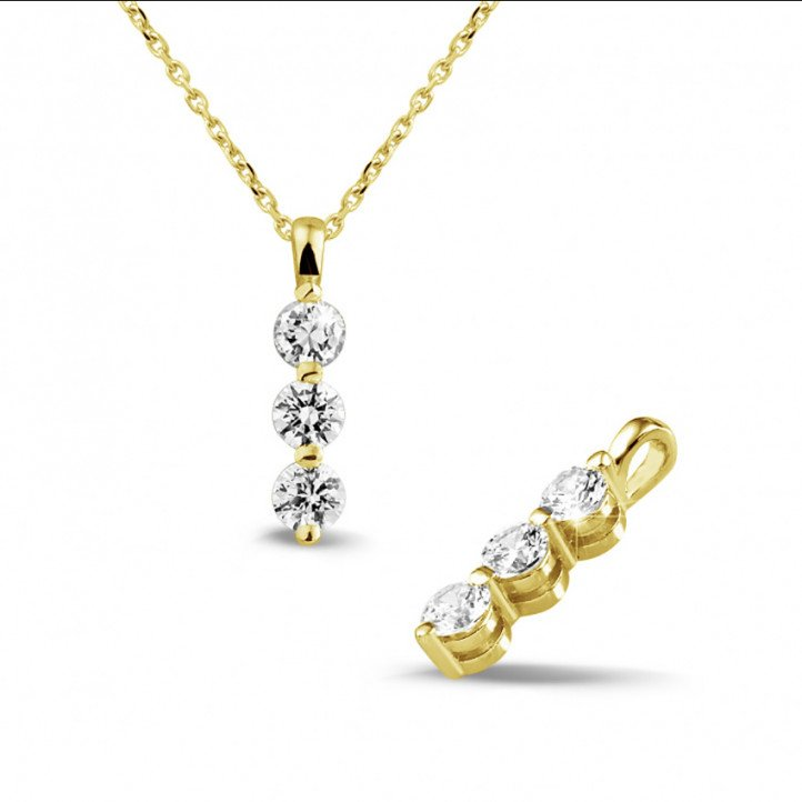 0.75 carat trilogy diamond pendant in yellow gold