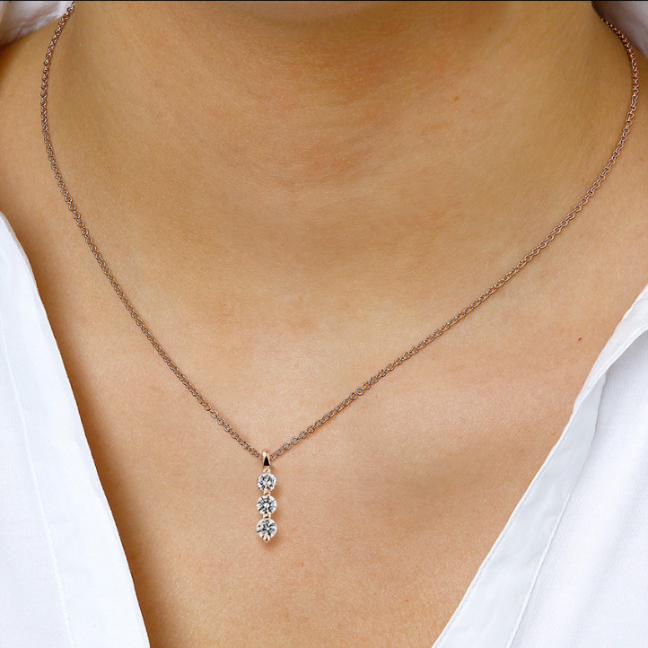 0.75 carat trilogy diamond pendant in red gold