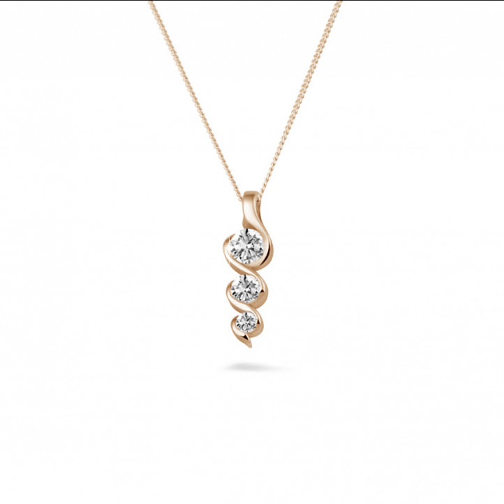 0.38 carat trilogy diamond pendant in red gold