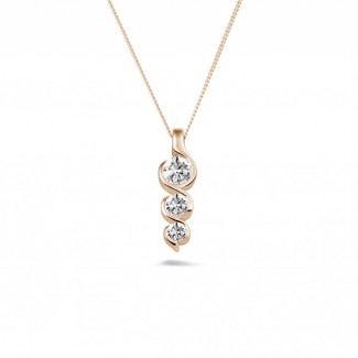 Diamond Pendants - 0.57 carat trilogy diamond pendant in red gold