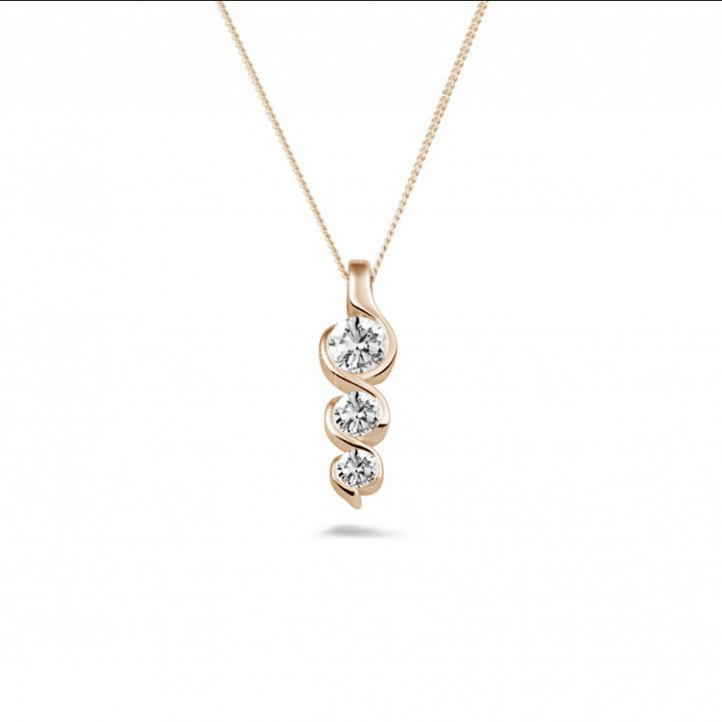 0.57 carat trilogy diamond pendant in red gold