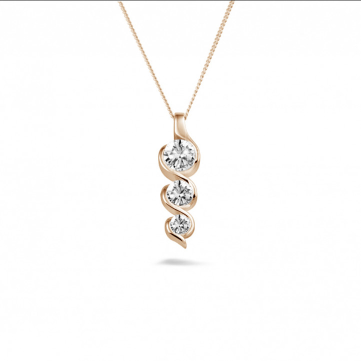 0.85 carat trilogy diamond pendant in red gold