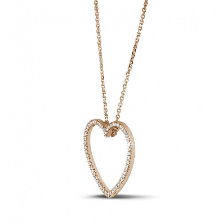 0.45 carat diamond heart shaped pendant in red gold