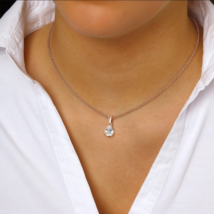 1.50 carat red golden solitaire pendant with pear shaped diamond