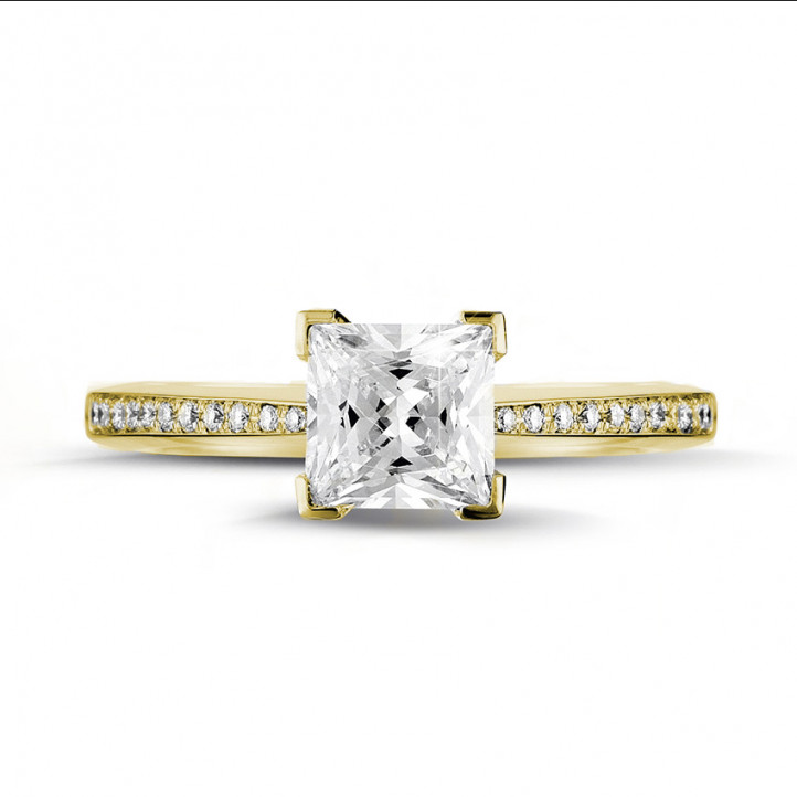 1.50 carat solitaire ring in yellow gold with princess diamond and side diamonds