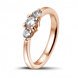 0.45 carat trilogy ring in red gold with round diamonds