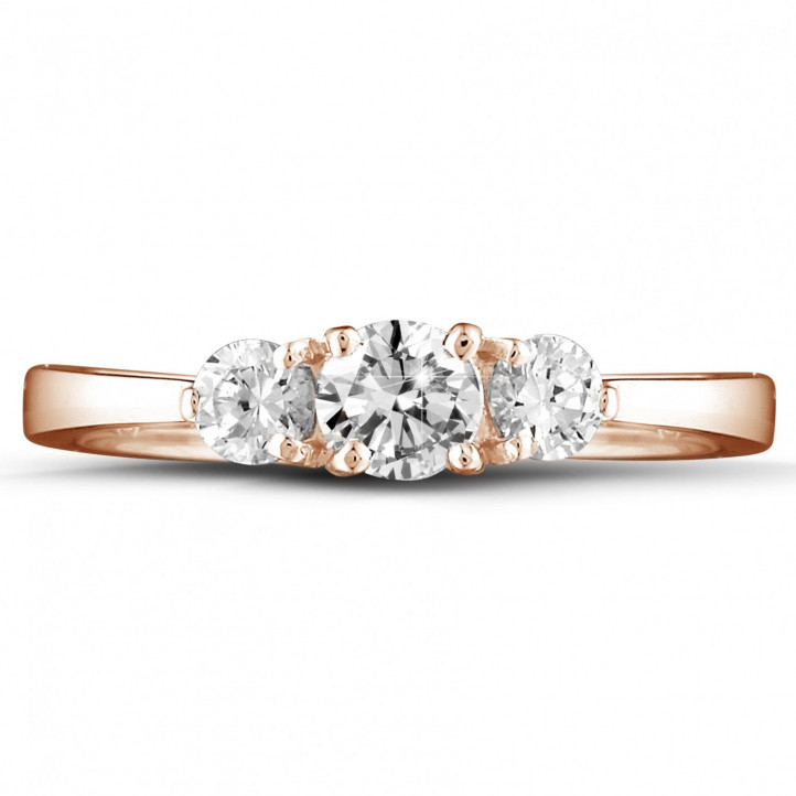 0.67 carat trilogy ring in red gold with round diamonds