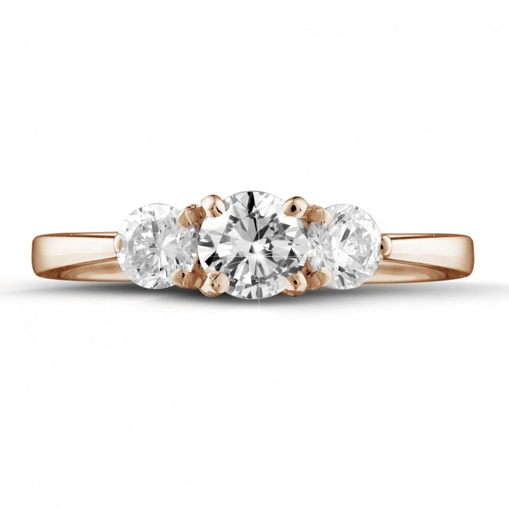 1.00 carat trilogy ring in red gold with round diamonds