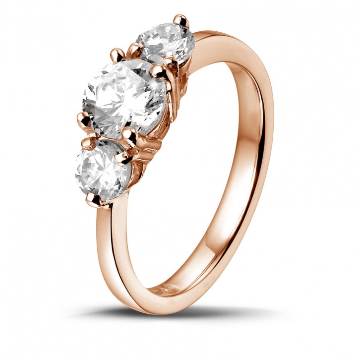 1.50 carat trilogy ring in red gold with round diamonds