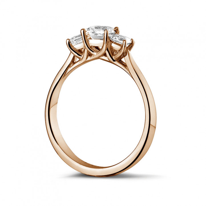 0.70 carat trilogy ring in red gold with princess diamonds