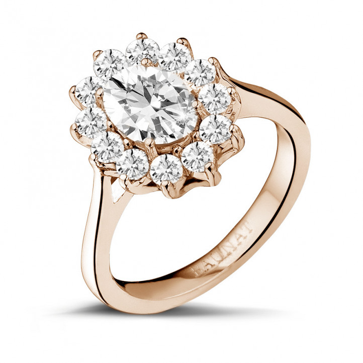 1.85 carat entourage ring in red gold with oval diamond