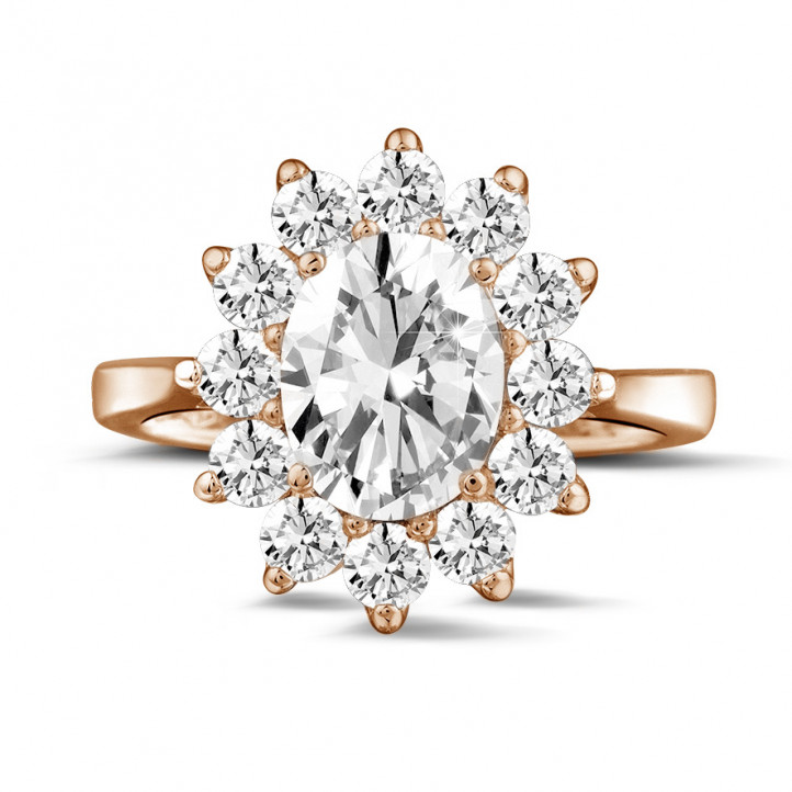 2.84 carat entourage ring in red gold with oval diamond