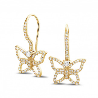 0.70 carat diamond butterfly designed earrings in yellow gold