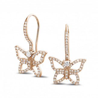 0.70 carat diamond butterfly designed earrings in red gold