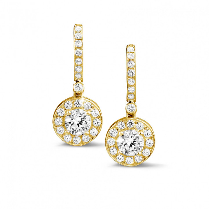 1.55 carat diamond halo earrings in yellow gold