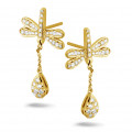 0.70 carat diamond dragonfly earrings in yellow gold