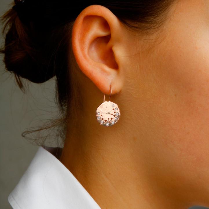 0.26 carat diamond design earrings in red gold