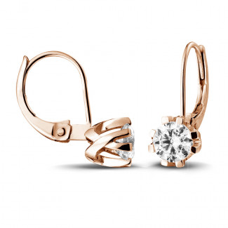 1.00 carat diamond design earrings in red gold with eight prongs