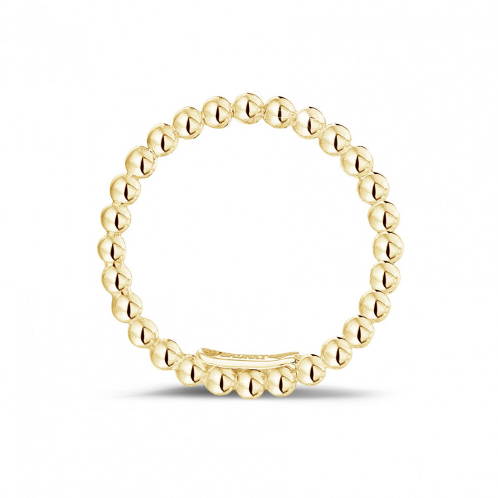 Stackable beaded ring in yellow gold