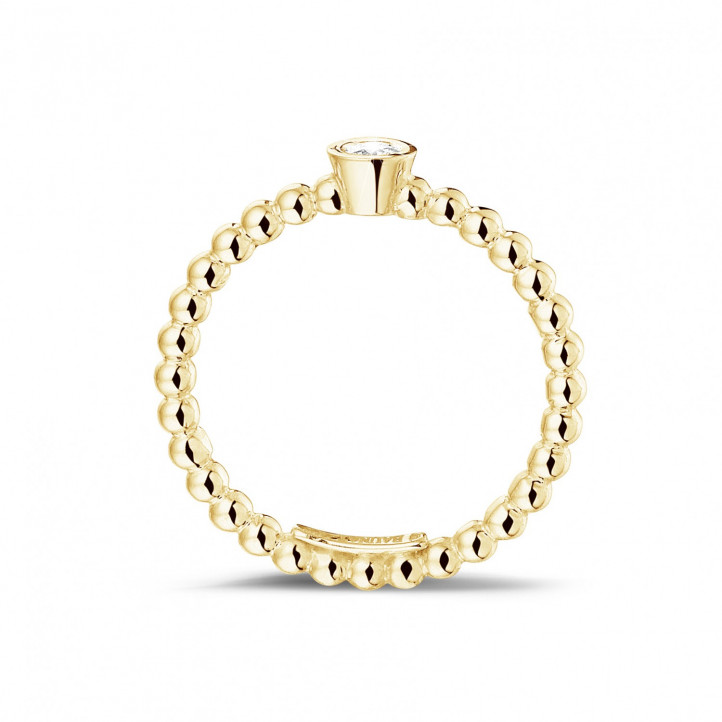 0.07 carat diamond stackable beaded ring in yellow gold