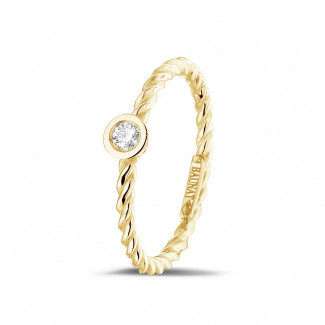 Yellow Gold Diamond Rings - 0.07 carat diamond stackable twisted ring in yellow gold