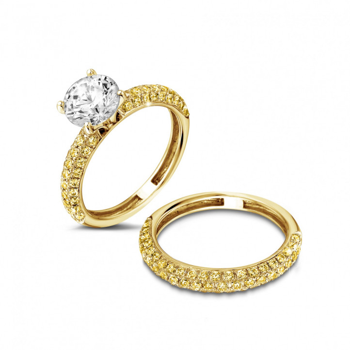1.50 carat solitaire ring (half set) in yellow gold with yellow side diamonds
