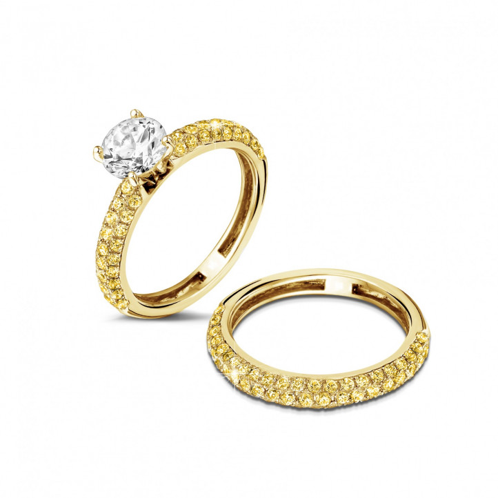 Matching engagement and wedding band in yellow gold with a central diamond of 1.20 carat and small yellow diamonds