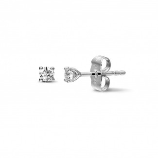 - 0.30 carat classic diamond earrings in white gold with four prongs