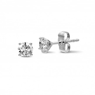 - 1.50 carat classic diamond earrings in white gold with four prongs