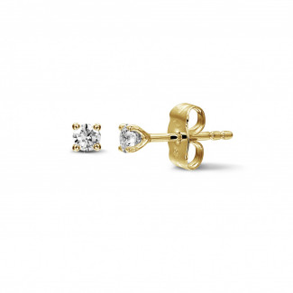 0.30 carat classic diamond earrings in yellow gold with four prongs