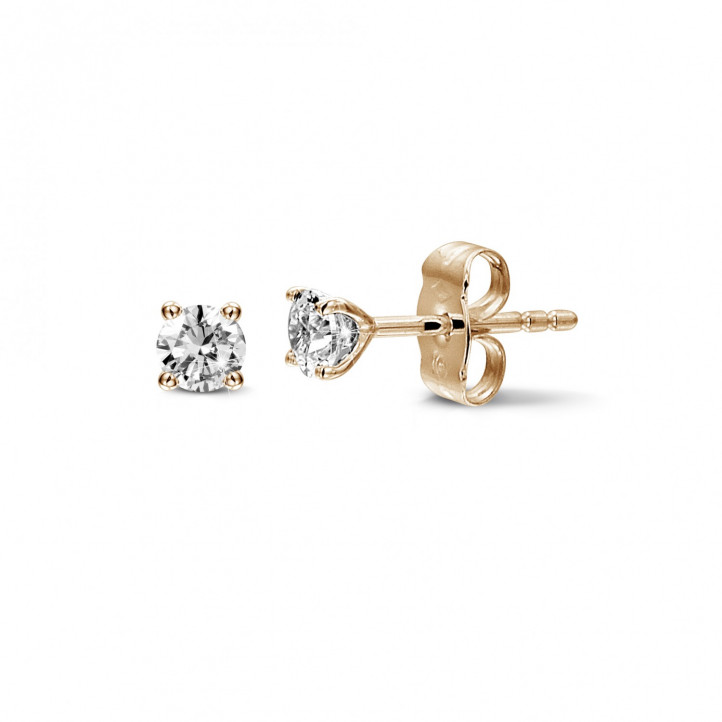 0.60 carat classic diamond earrings in red gold with four prongs