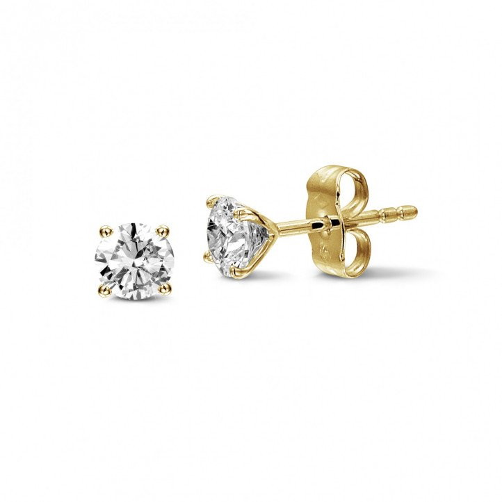 1.50 carat classic diamond earrings in yellow gold with four prongs