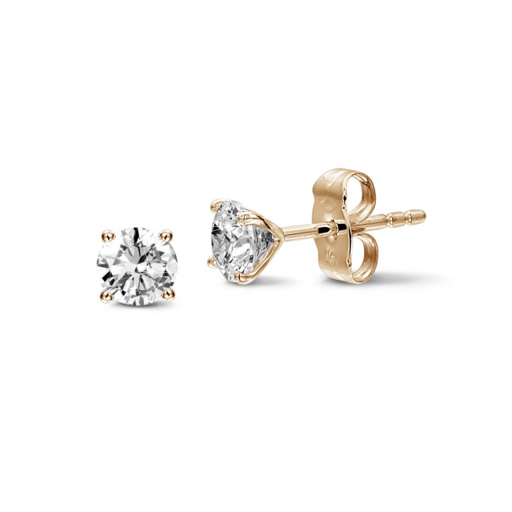 1.50 carat classic diamond earrings in red gold with four prongs