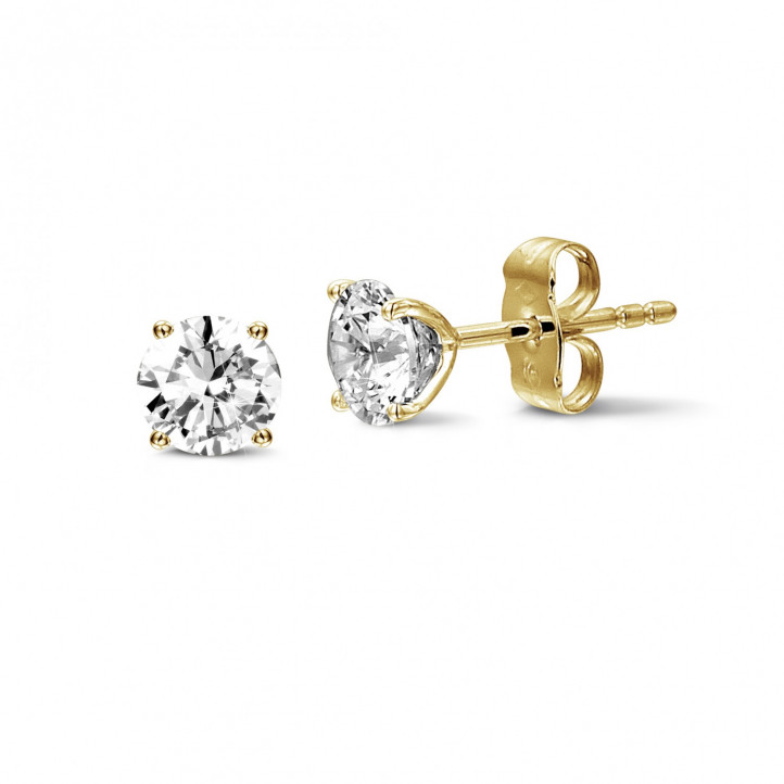 2.00 carat classic diamond earrings in yellow gold with four prongs