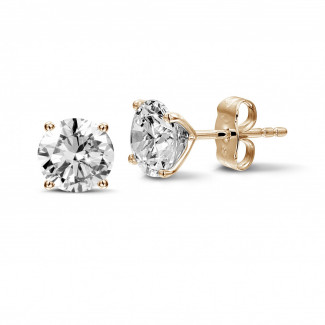 2.50 carat classic diamond earrings in red gold with four prongs