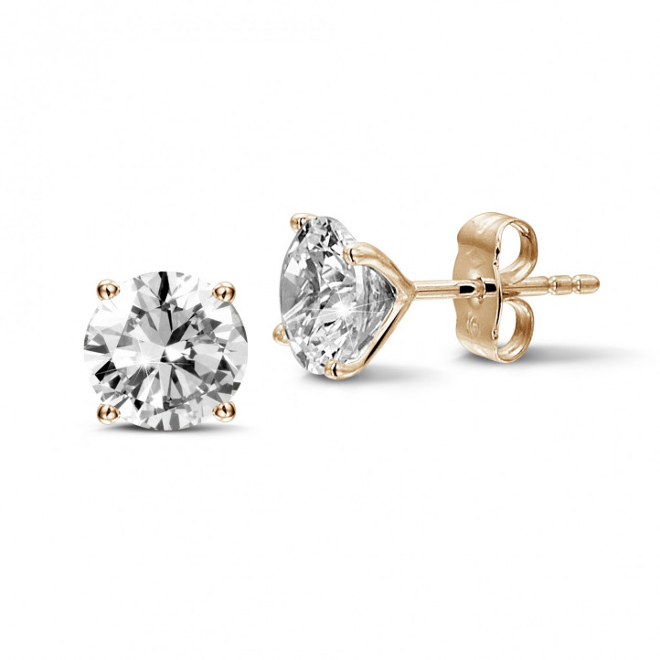 3.00 carat classic diamond earrings in red gold with four prongs