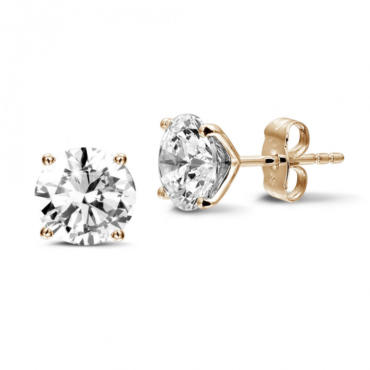 4.00 carat classic diamond earrings in red gold with four prongs