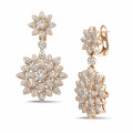 3.65 carat diamond flower earrings in red gold
