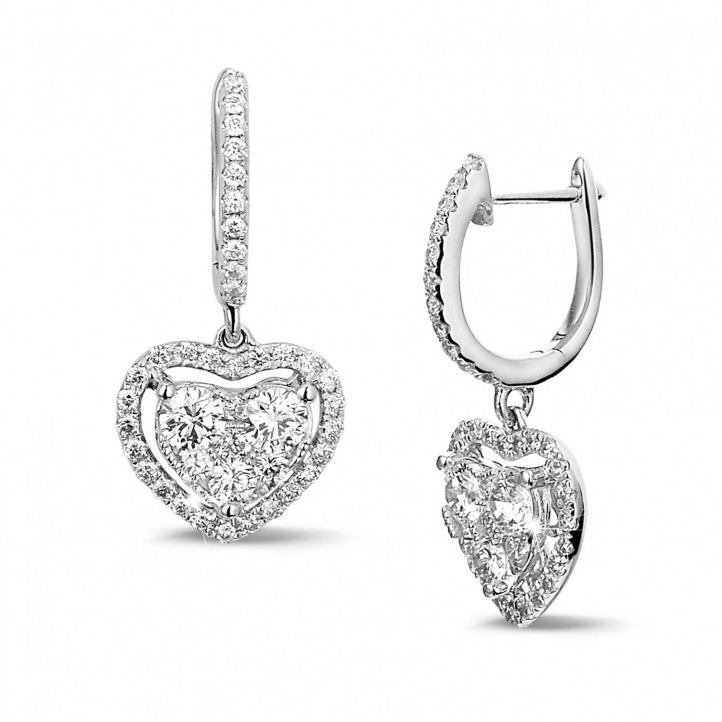 1.35 carat heart-shaped earrings in white gold with round diamonds