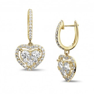 1.35 carat heart-shaped earrings in yellow gold with round diamonds